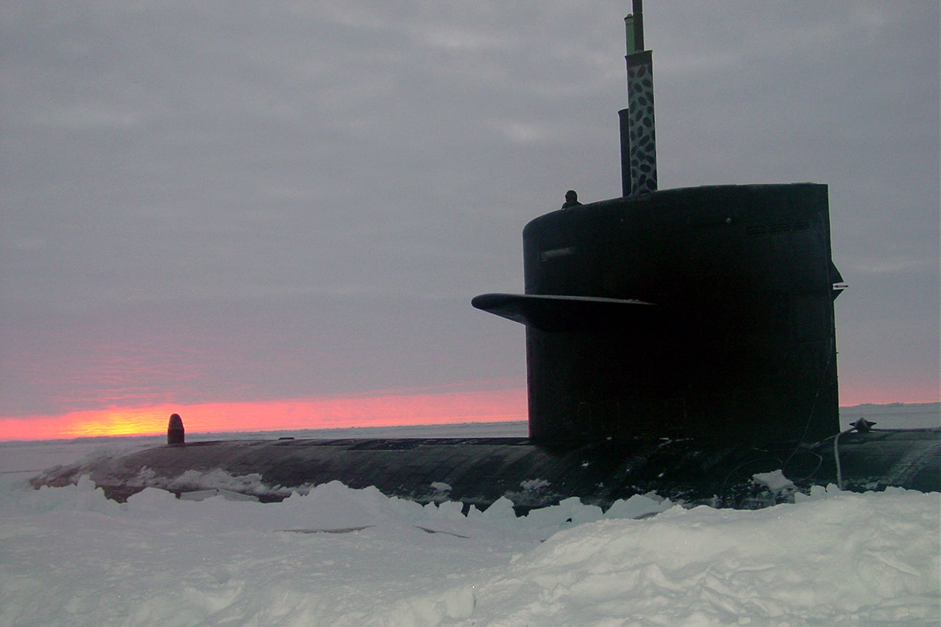 031000-N-XXXXB-004 Arctic Circle (Oct. 2003) -- The Los Angeles-class fast attack submarine USS Honolulu (SSN 718) sits surfaced 280 miles from the North Pole at sunset. Commanded by Cmdr. Charles Harris, USS Honolulu while conducting otherwise classified operations in the Arctic, collected scientific data and water samples for U.S. and Canadian Universities as part of an agreement with the Artic Submarine Laboratory (ASL) and the National Science Foundation (NSF).  USS Honolulu is the 24th Los Angeles-class submarine, and the first original design in her class to visit the North Pole region.  Honolulu is as assigned to Commander Submarine Pacific, Submarine Squadron Three, Pearl Harbor, Hawaii.  U. S. Navy photo by Chief Yeoman Alphonso Braggs.  (RELEASED)