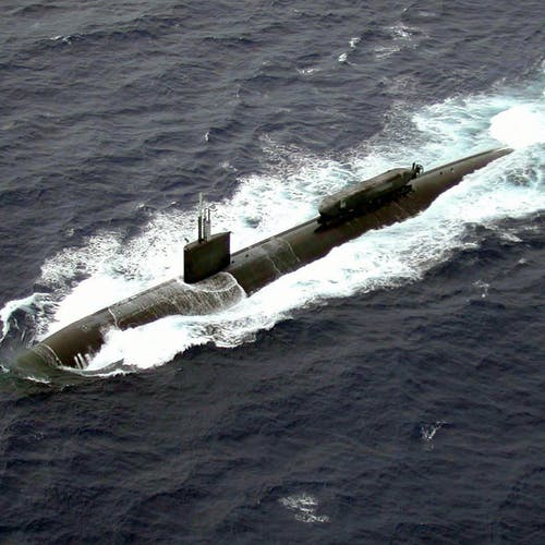 030701-N-0000X-005 The Pacific Ocean (Jul. 1, 2003) -- The Los Angeles-class submarine USS Greenville (SSN 772) recently completed sea testing for the Advanced SEAL Delivery System (ASDS) off the coast of Pearl Harbor, Hawaii.  ASDS is an 65 foot mini-submarine, which rides attached to the top of a much larger Los Angeles Class submarine.  It has increased range, speed, and capacity over the current SEAL Delivery Vehicle which is an open, wet submersible, that transports SEALs in scuba gear, exposing them longer to the elements.  The ASDS mini-submarine is operated by a crew of two and can carry eight SEAL team members. The vessel is connected to the host ship via a watertight hatch, and has a sophisticated sonar and a hyperbaric recompression chamber.  U.S. Navy photo.  (RELEASED)