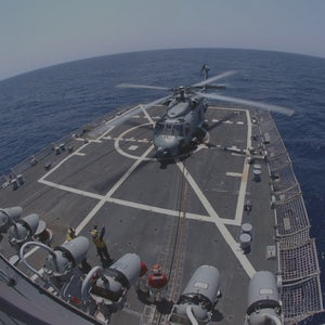 """060504-N-2258R-001 Atlantic Ocean (May 4, 2006) - An SH-60 from Helicopter Anti-submarine Squadron Light Forty-Six (HSL-46), the """"Grandmasters,"""" prepares to lift off from the flight deck of the Arleigh Burke-class guided missile destroyer USS Mason (DDG 87). Mason is participating in the Eisenhower Carrier Strike Group Composite Training Unit Exercise (COMPTUEX).  U.S. Navy photo by Photographer's Mate 3rd Class Pedro A. Rios Alvarez"""